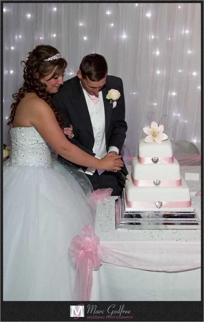 Cutting-the-Wedding-Cake-at-a-Brandshatch-Thistle-Hotel-Wedding